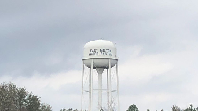 A water tower labeled East Milton Water System