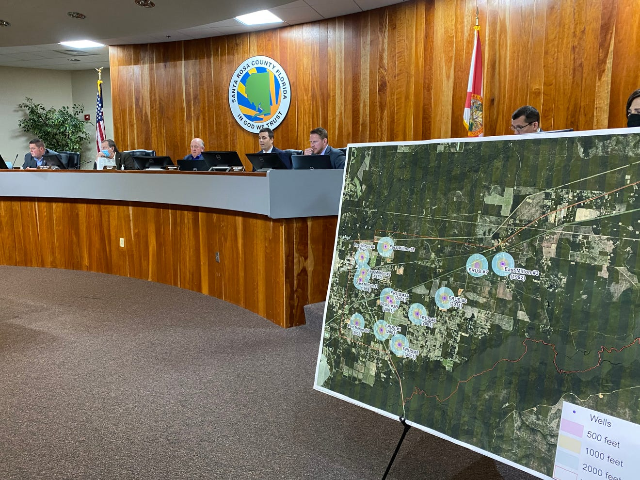 A board showing a map of borrow pits in Santa Rosa County on display at a County Commission meeting