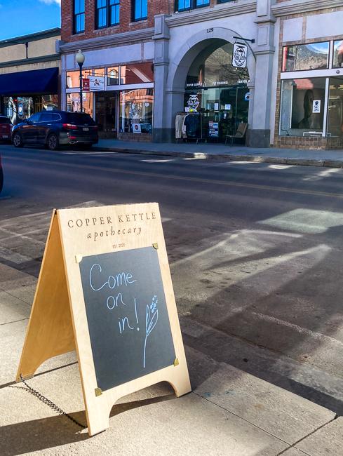 Sidewalk sign with writeable chalkboard section on a sidewalk