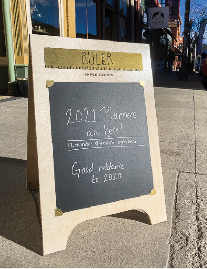 Sidewalk sign with chalkboard section