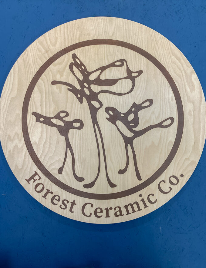Custom business sign made of engraved wood
