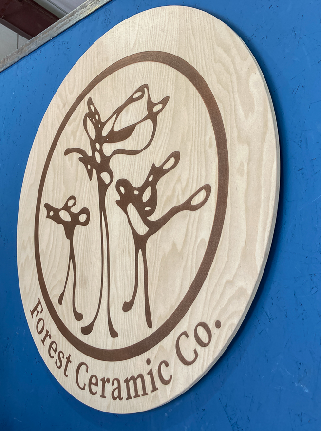 Custom wooden wall mounted sign