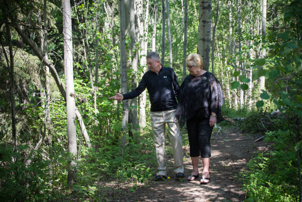 Trail Couple Looking at Plants