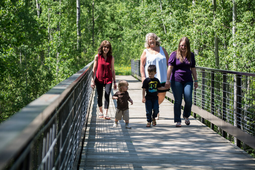 Trail Family Walking on Bridge
