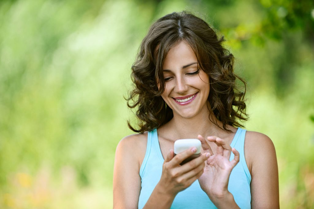 woman texting with an online counselor