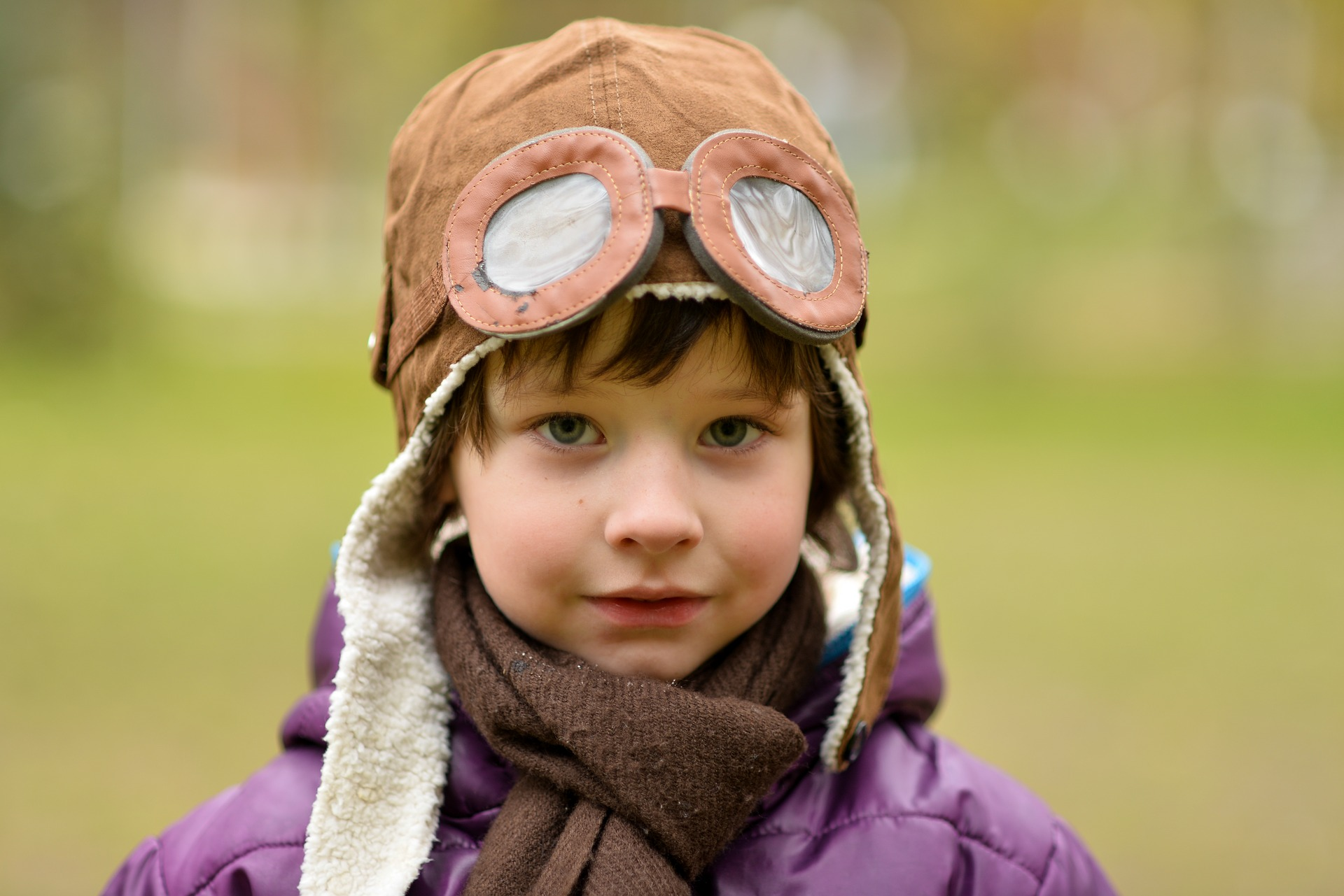 imaginative and confident child wearing a pilot's outfit