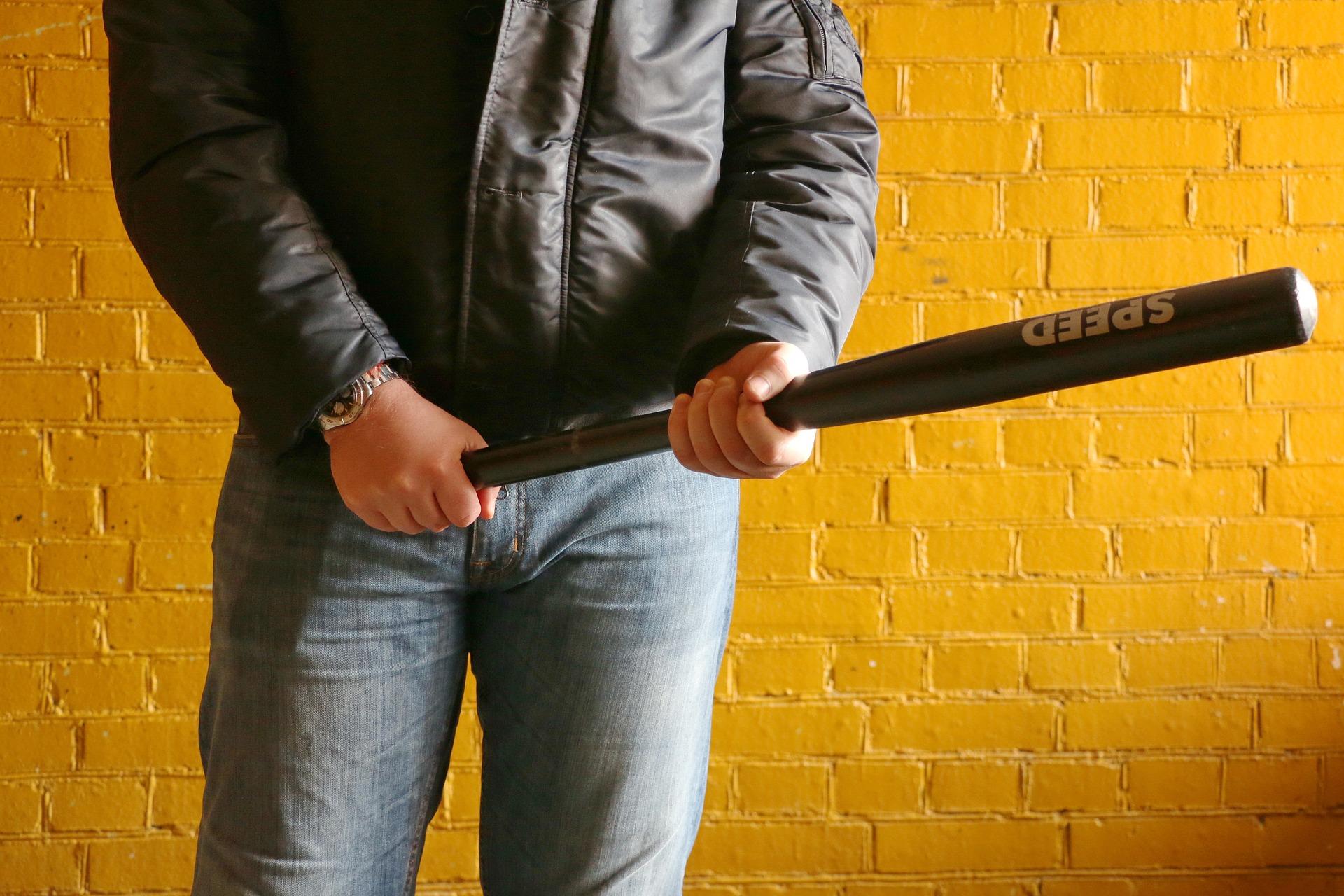 A mugger with a baseball bat