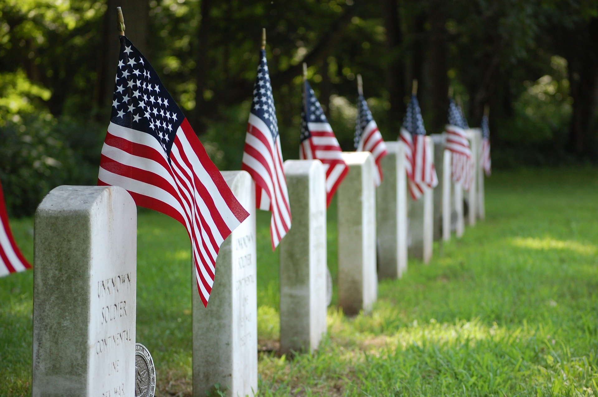 military graves with flags