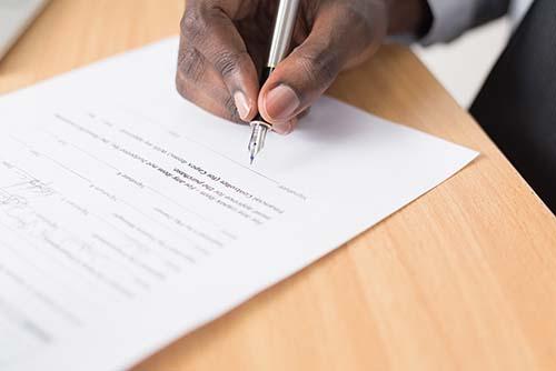 Man signing insurance paperwork