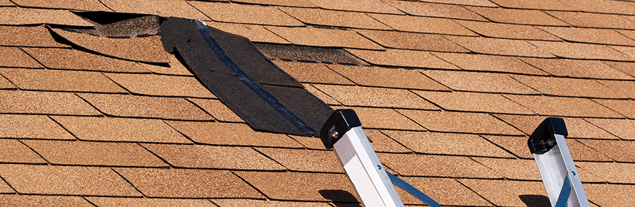 Loose shingles on roof being repaired