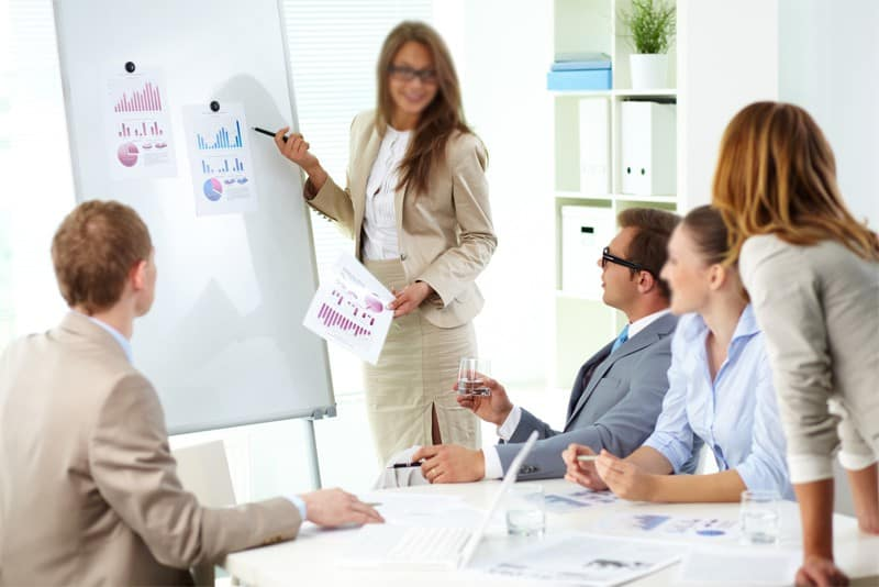 Woman in Heels at Work Making a Presentation