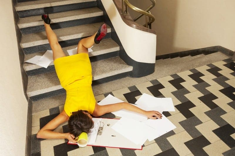 Woman in Yellow Dress At Office Falls Down Stairs