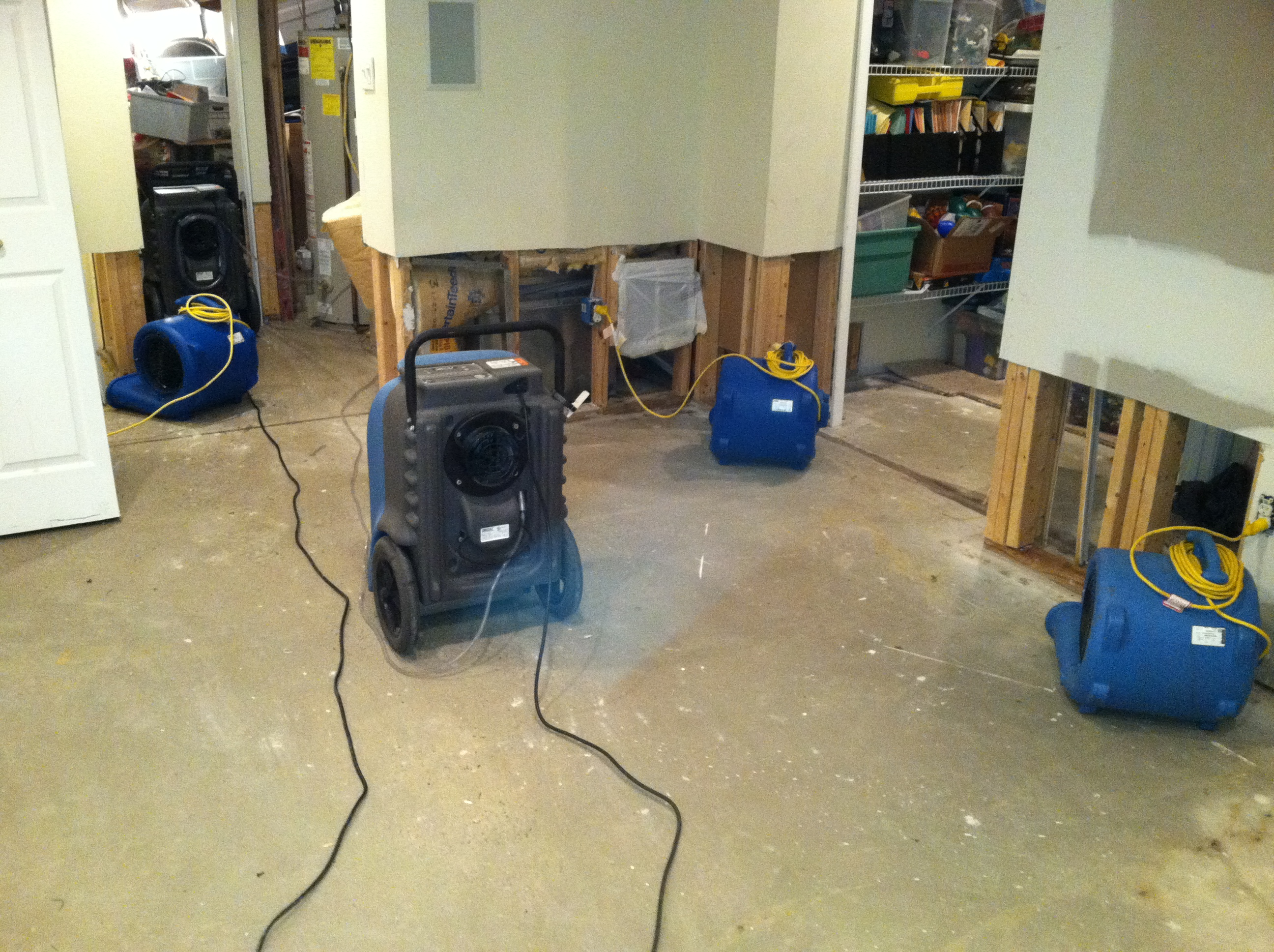 Image of drying fans in a previously flooded basement dwelling