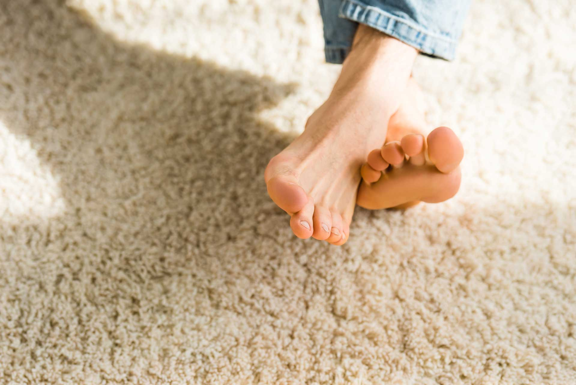 Image of bare feet on clean carpet free of water stains