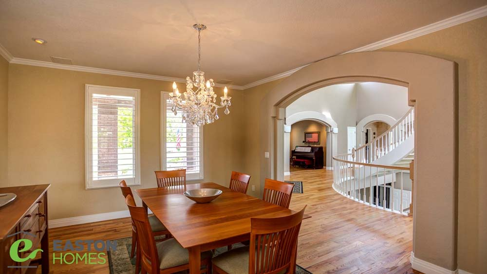 dining room with wooden furniture and large chandelier