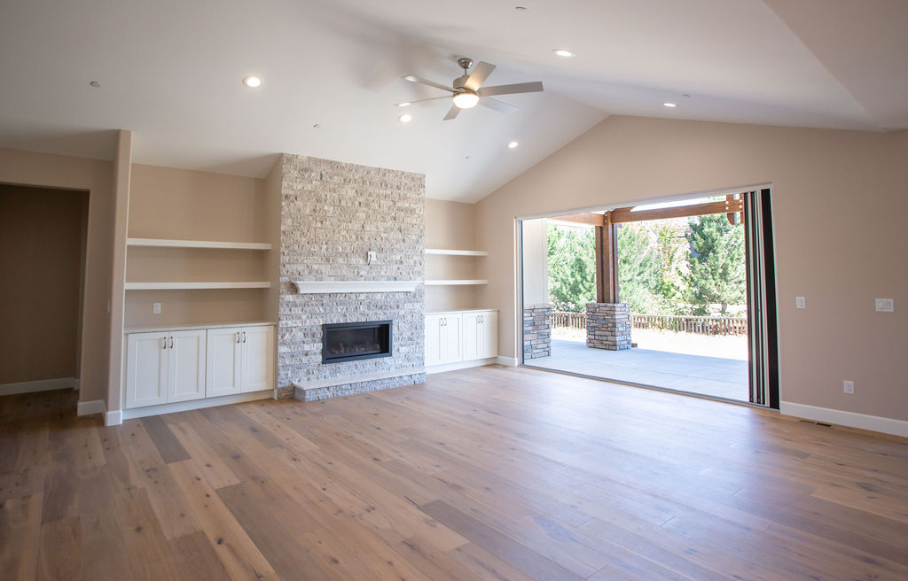 empty room with hardwood floors and fireplace
