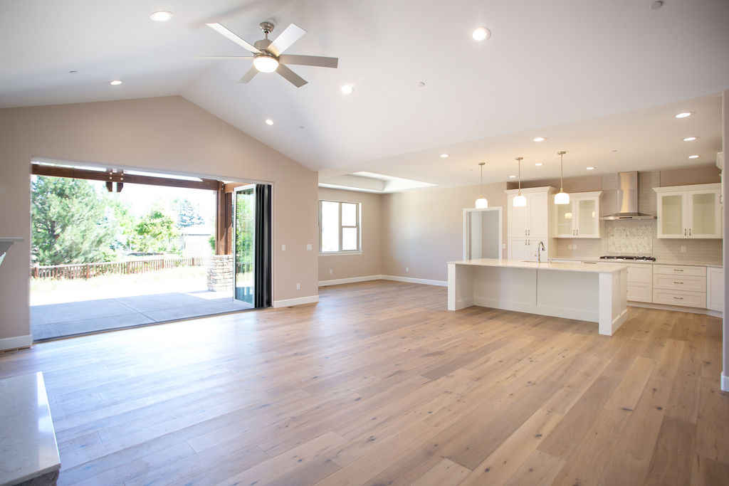 empty kitchen with hardwood floors and exit