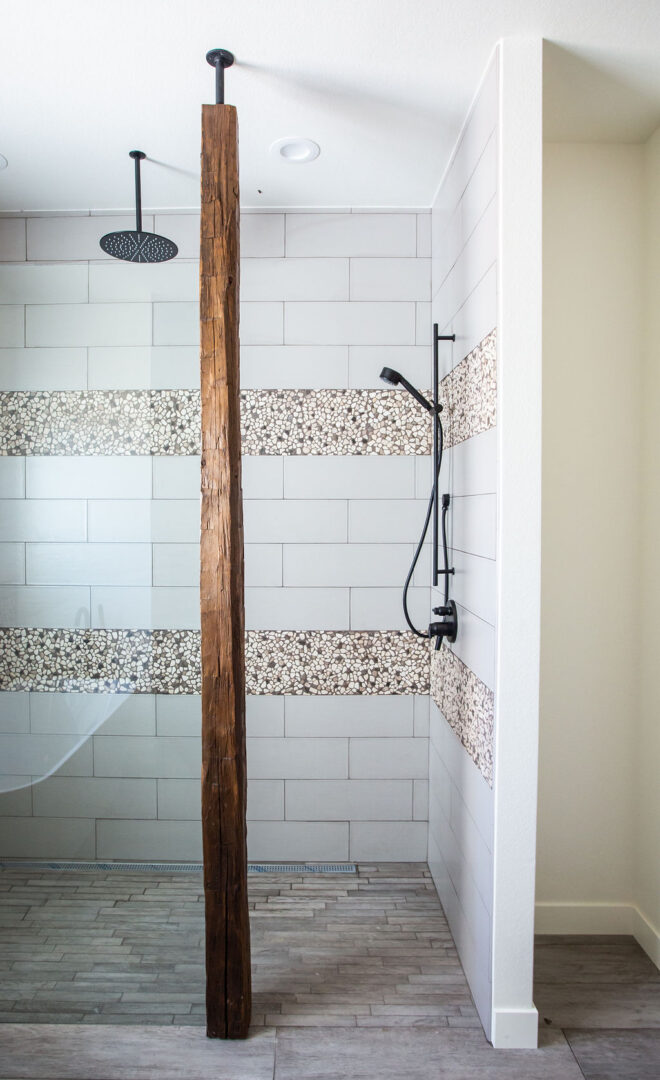 bathroom enclosure with wooden accent