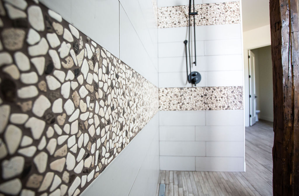 cloes up of tile with pebble designs