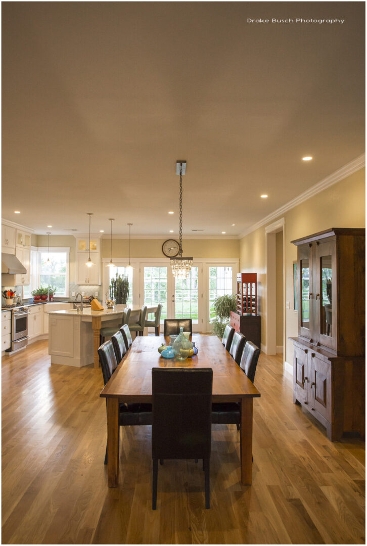 dining table with kitchen on the side