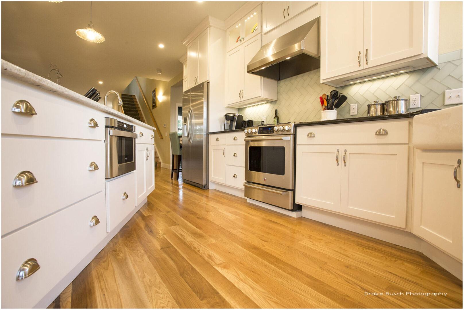 kitchen with hardwood floors and white furnishings