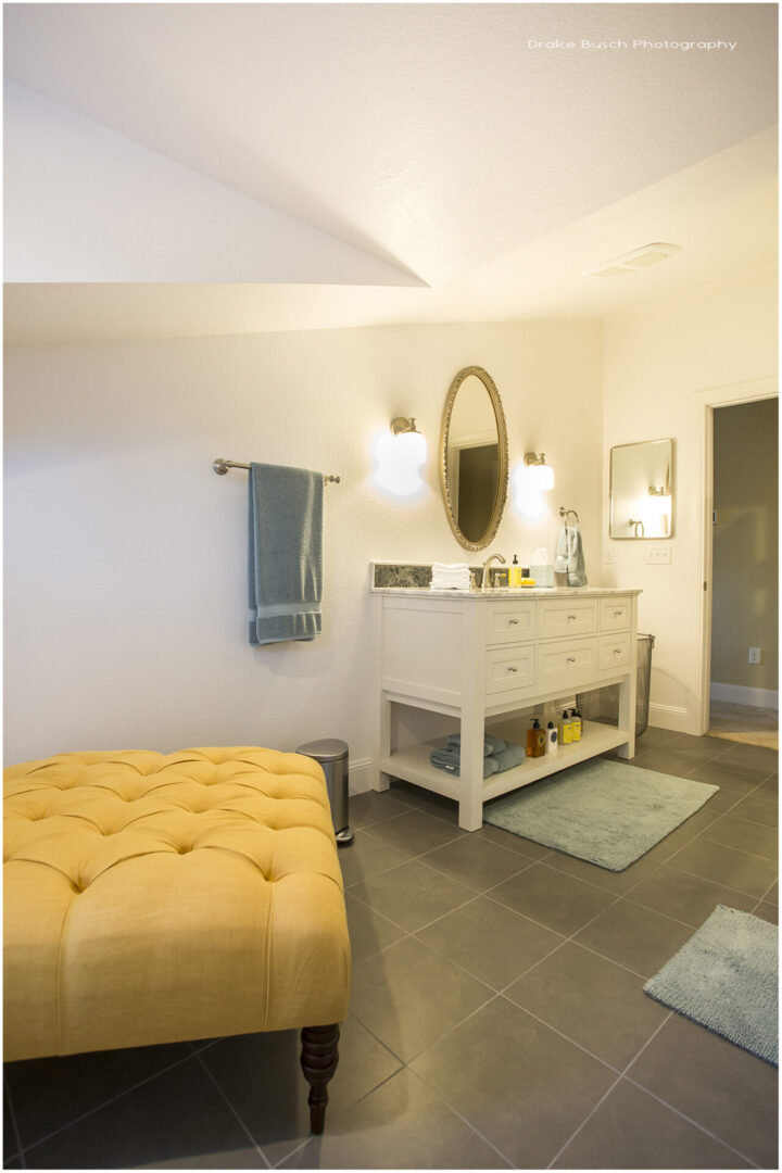 vanity table and large yellow seat
