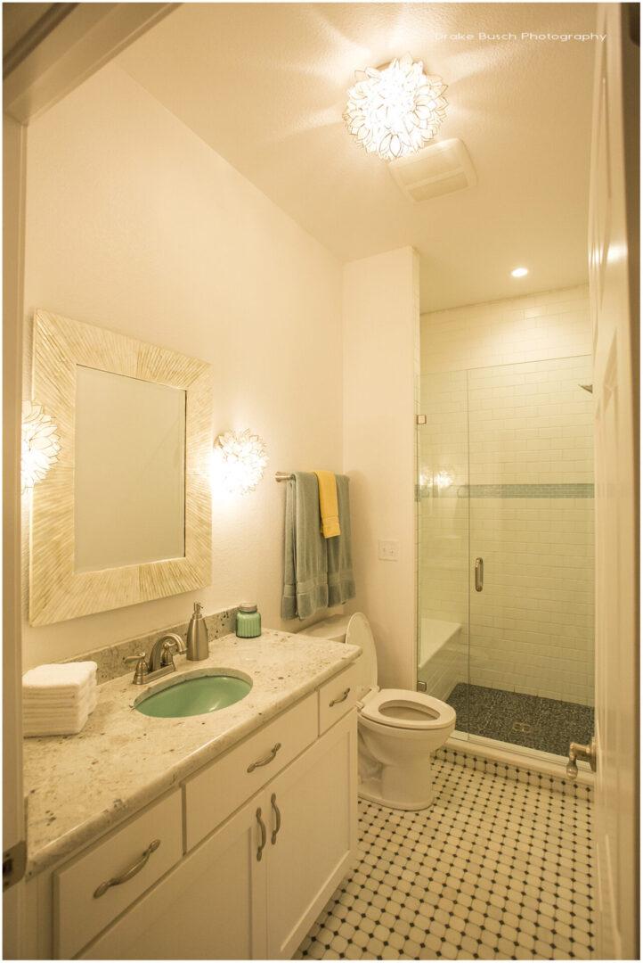 modern bathroom with fancy, warm white lights