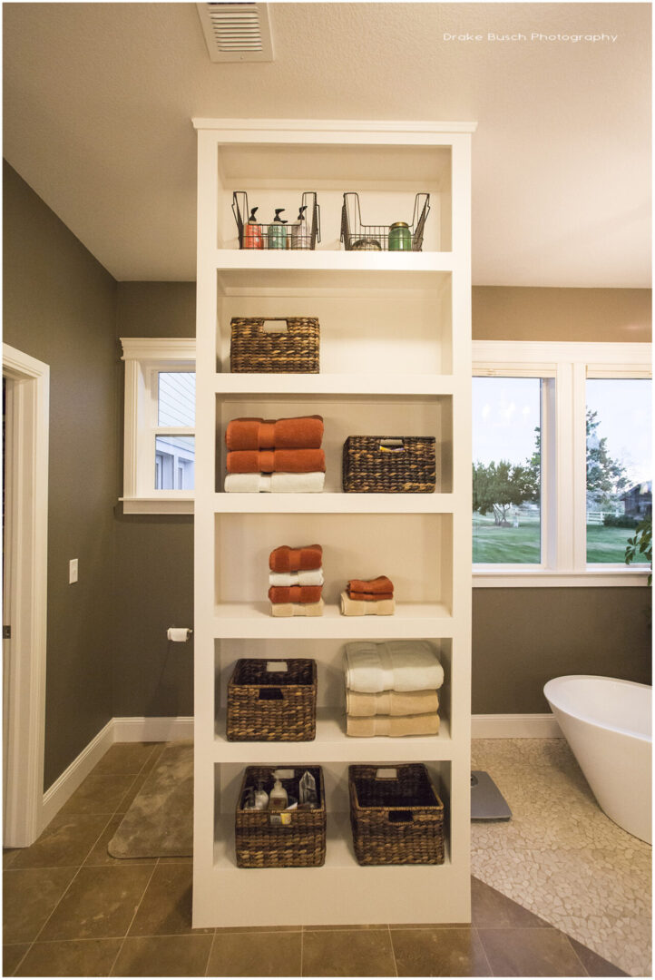 bathroom open cabinet with towels