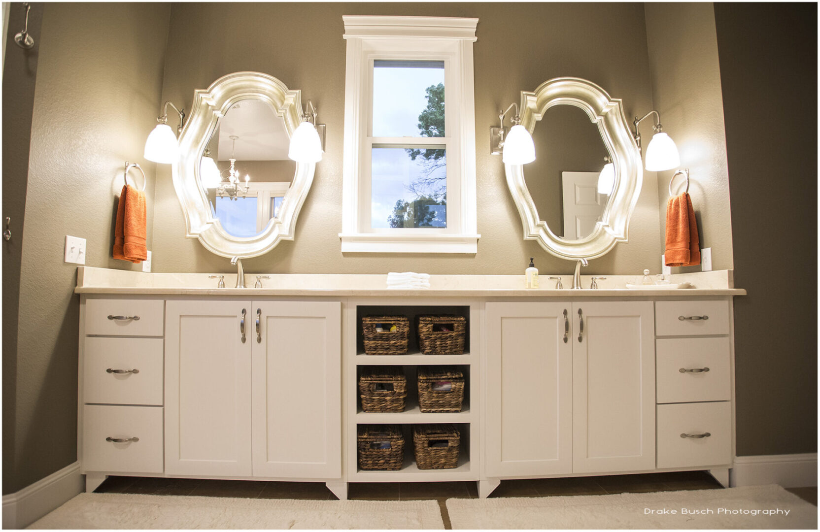 modern bathroom sink with framed mirrors and warm lights
