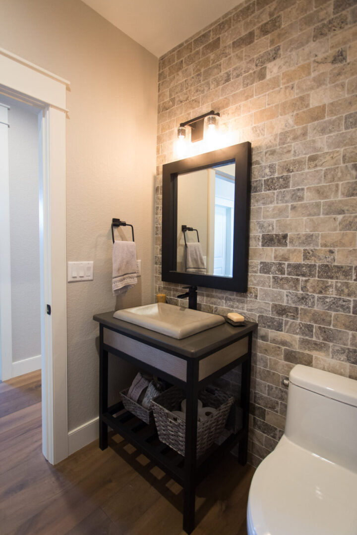 bathroom sink with rough tile background