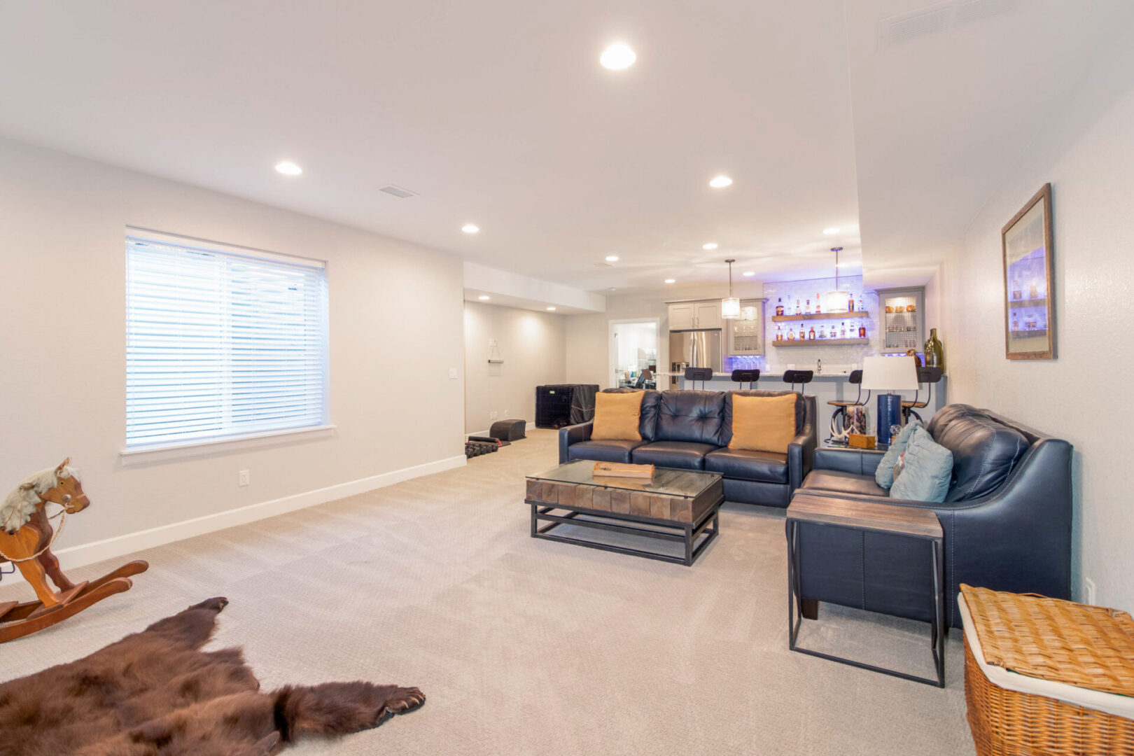 living room with bear fur carpet and modern lighting