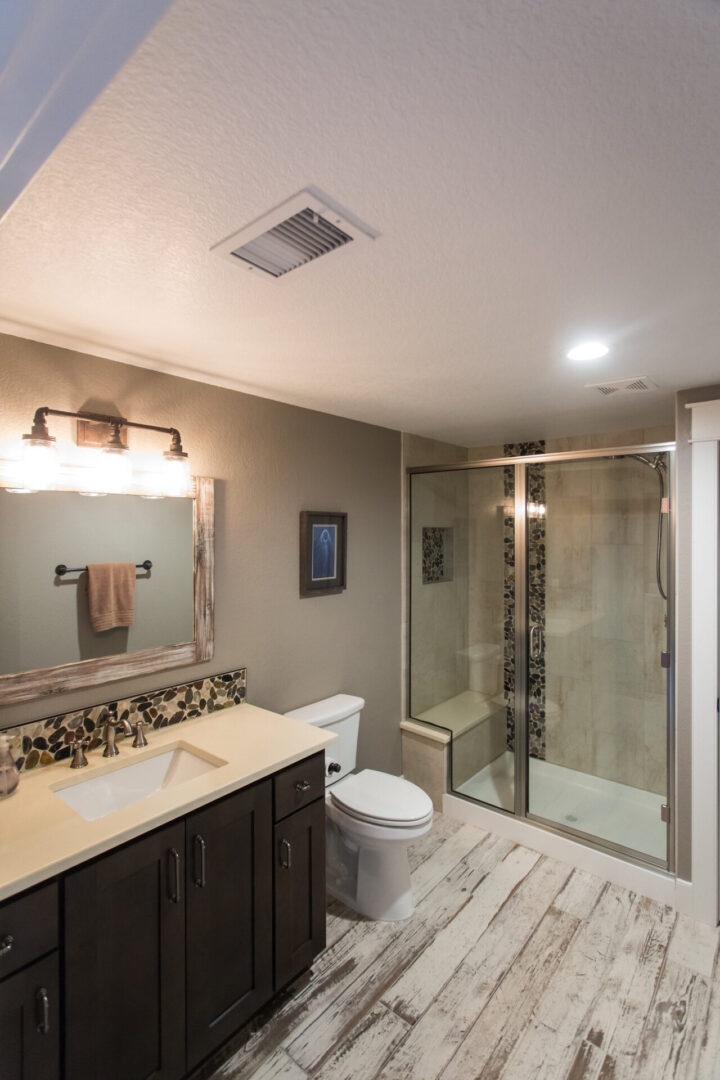 bathroom with modern sink and shower enclosure