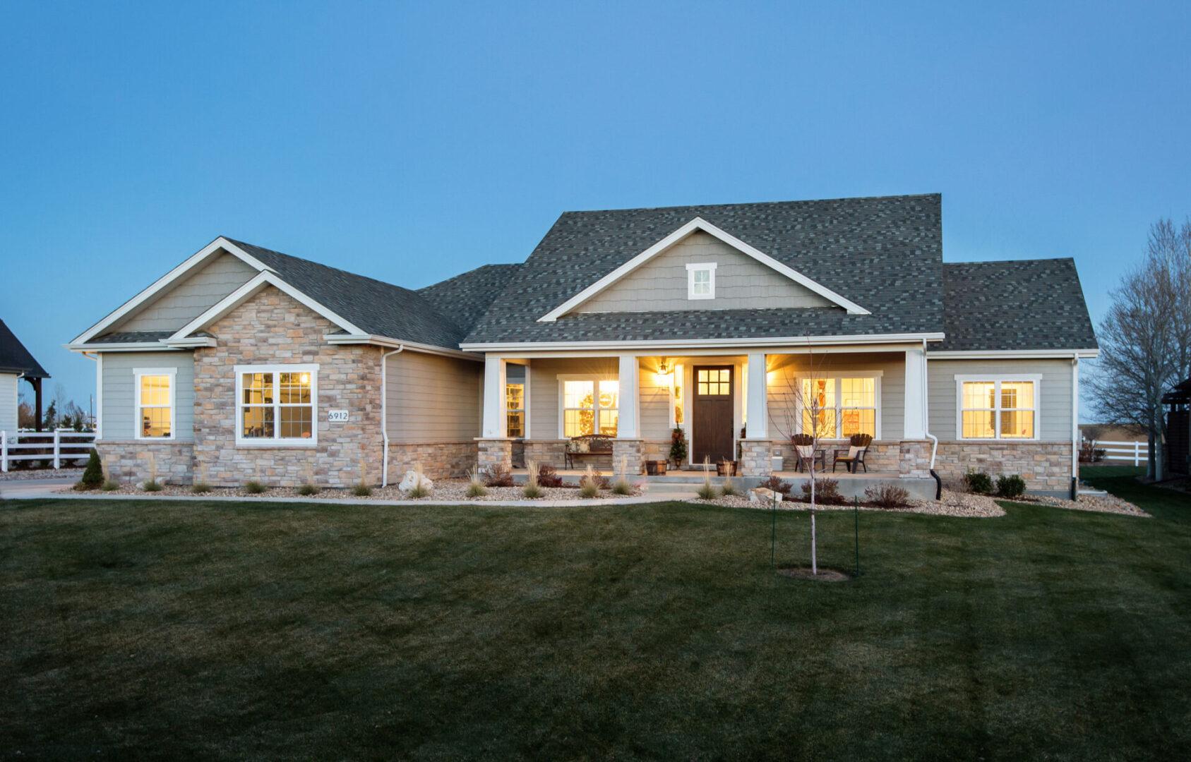 modern house with clean cut grass yard