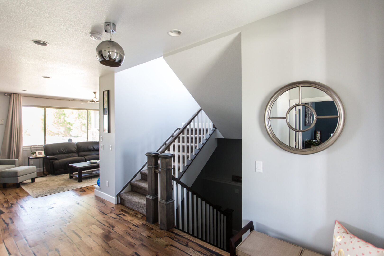 staircase with large circular mirror