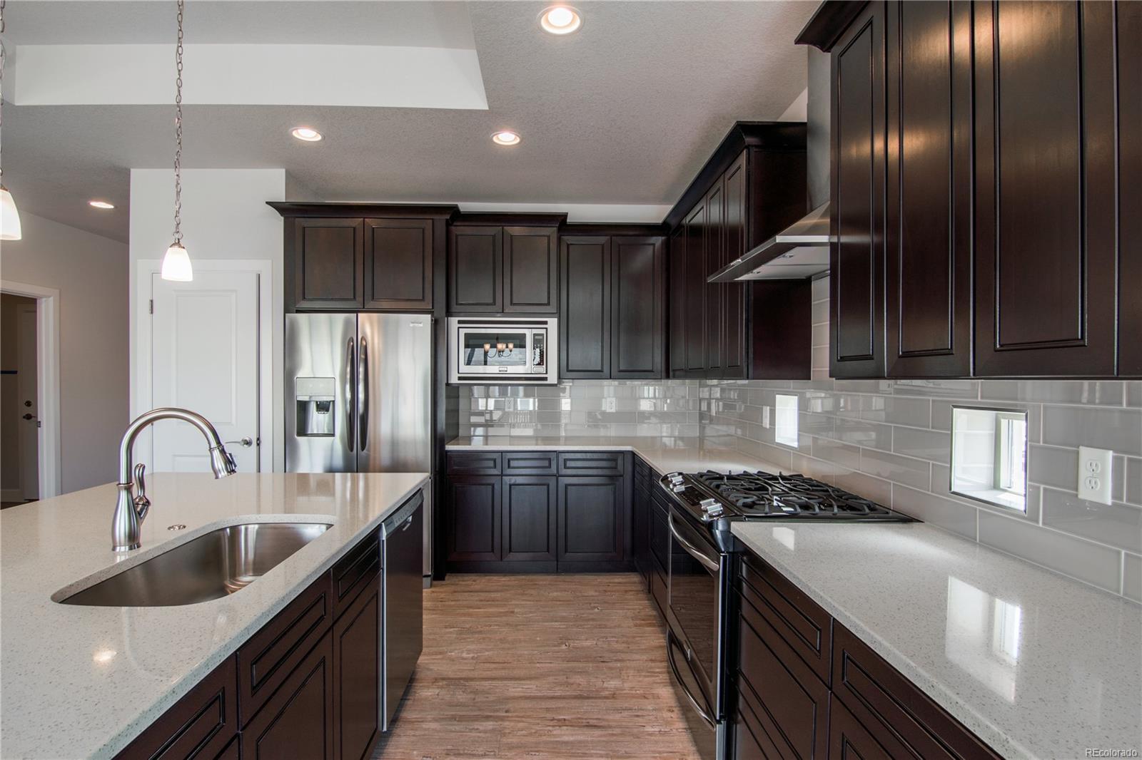 modern kitchen with range and island