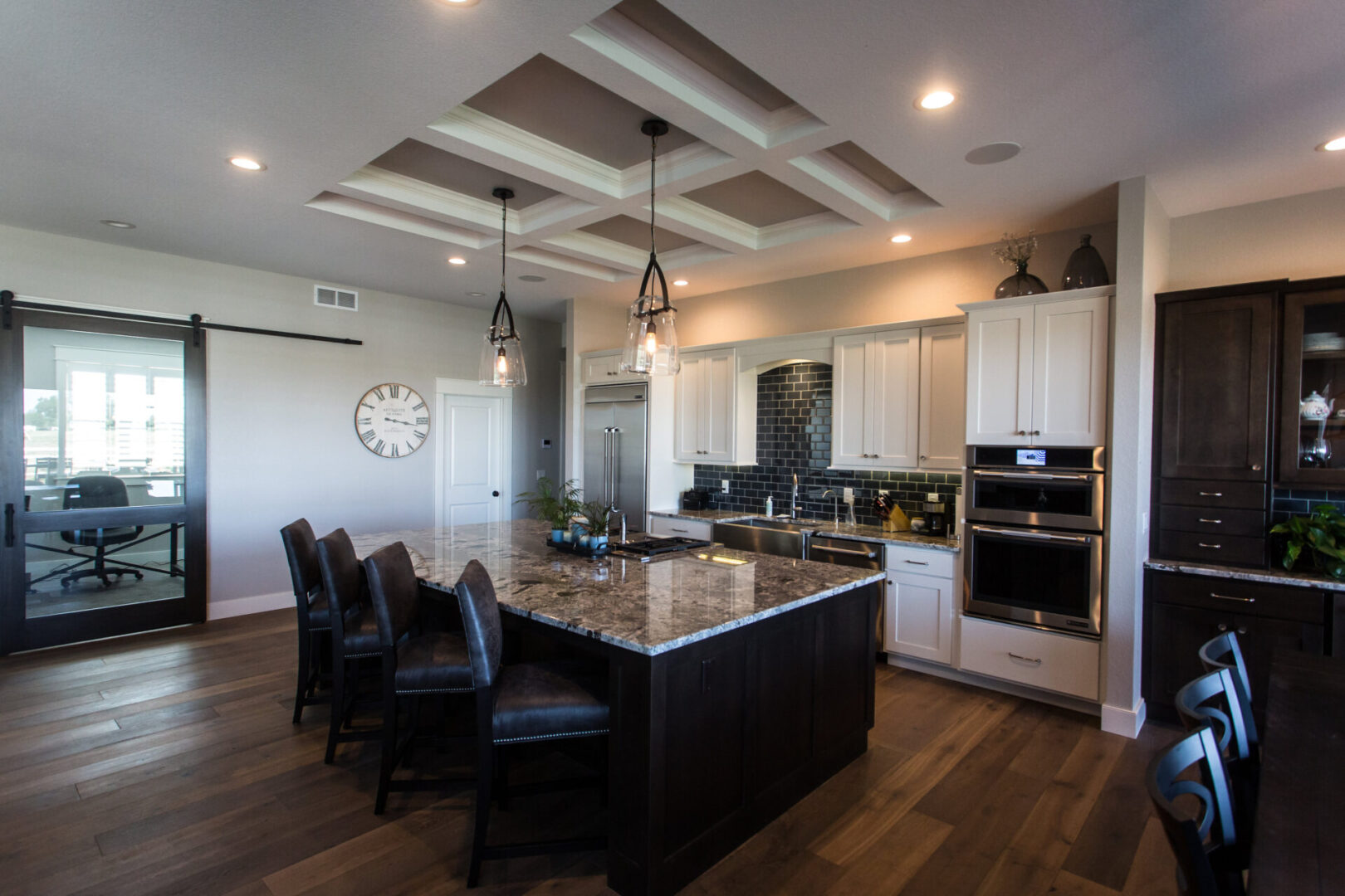 modern kitchen with marble countertop and chairs