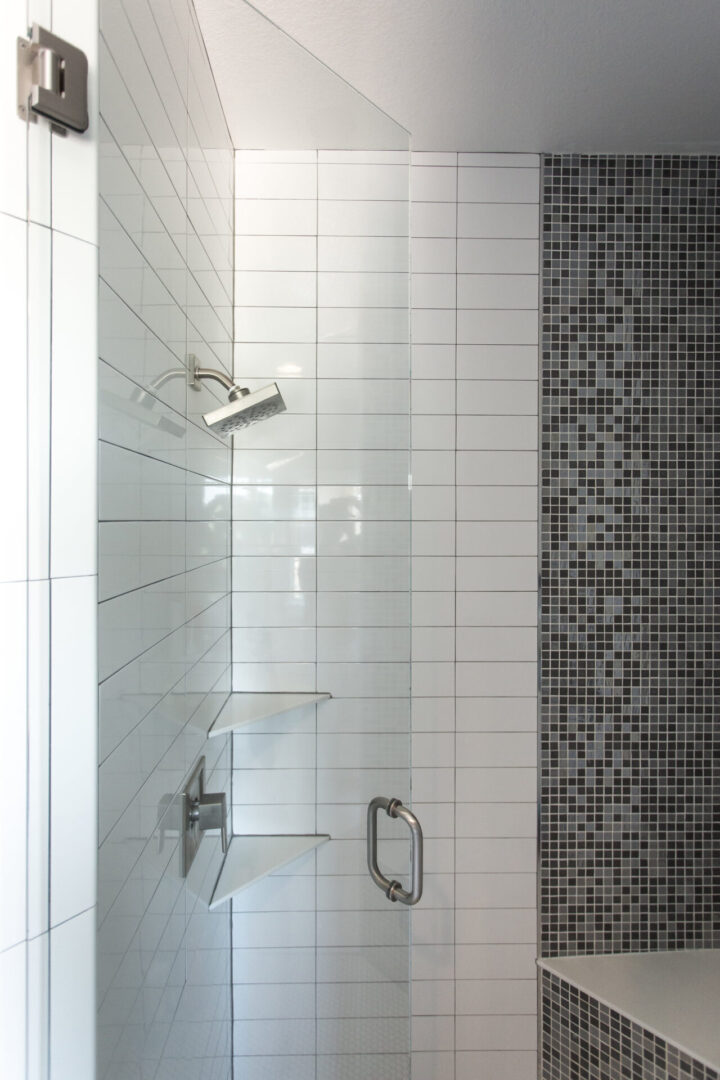 shower enclosure with rectangular white tiles