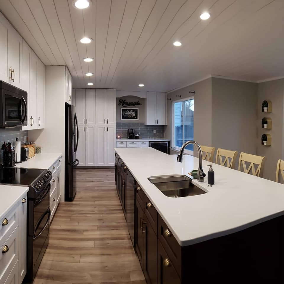 kitchen with sink and countertop and white cabinets