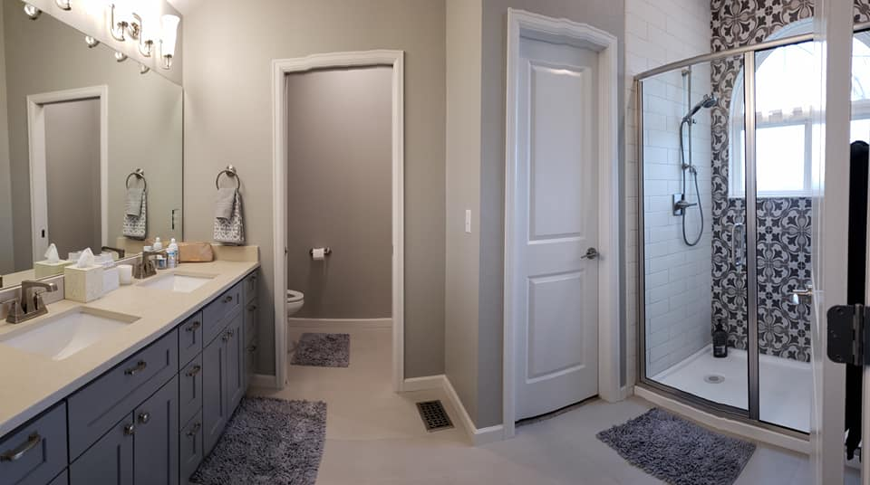 bathroom with shower enclosure, sink, and hidden toilet
