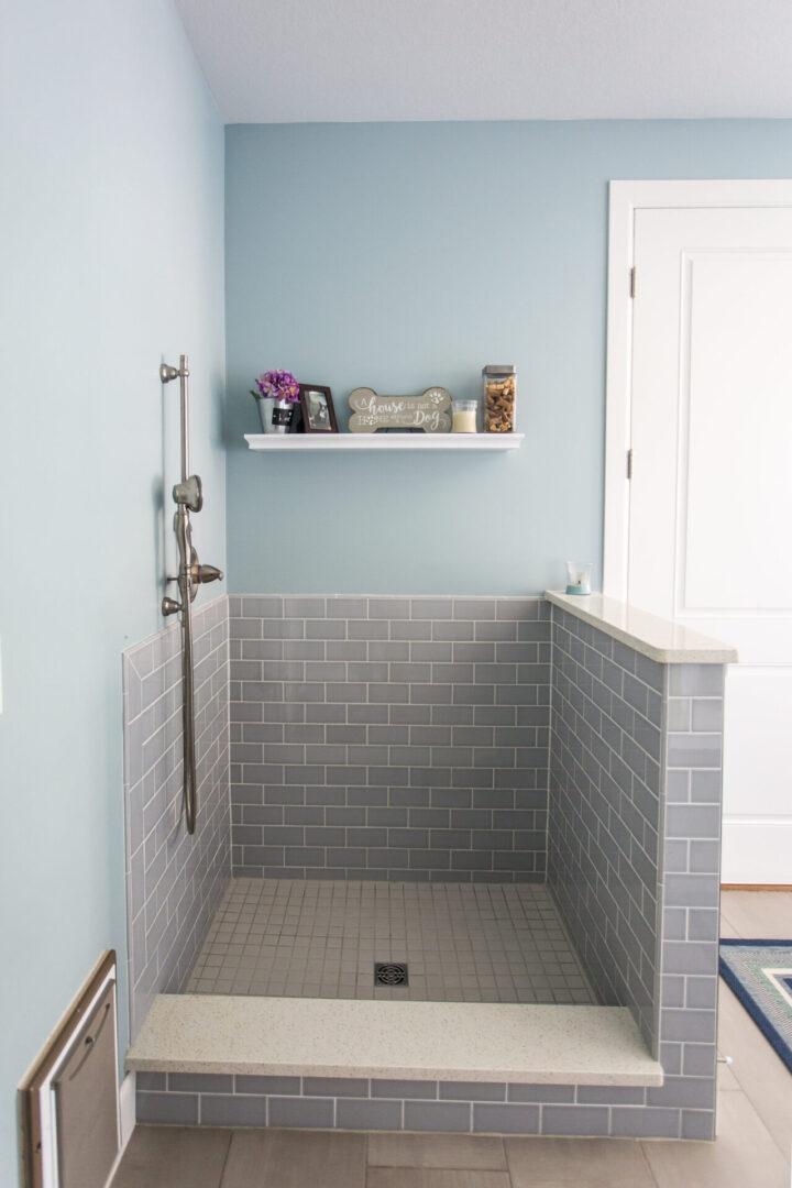 waist-high tiled shower enclosure