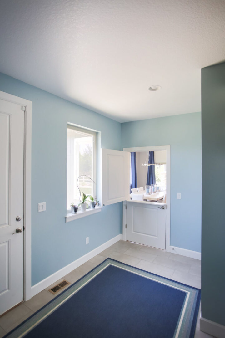 room with light blue wallpaper