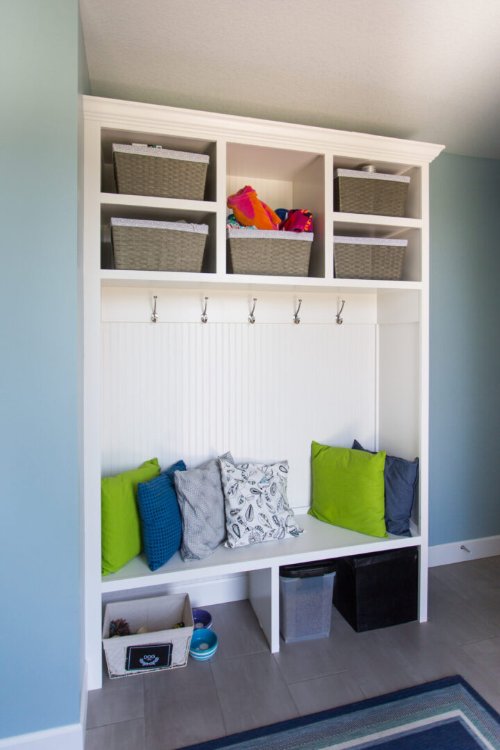 open cabinets with pillows