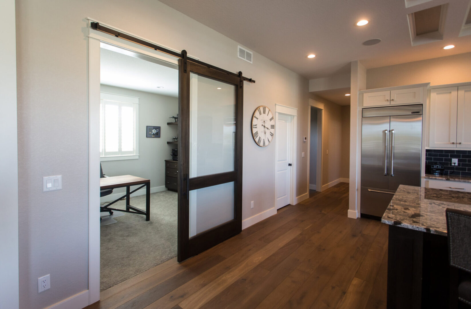 kitchen with large clock and sliding door