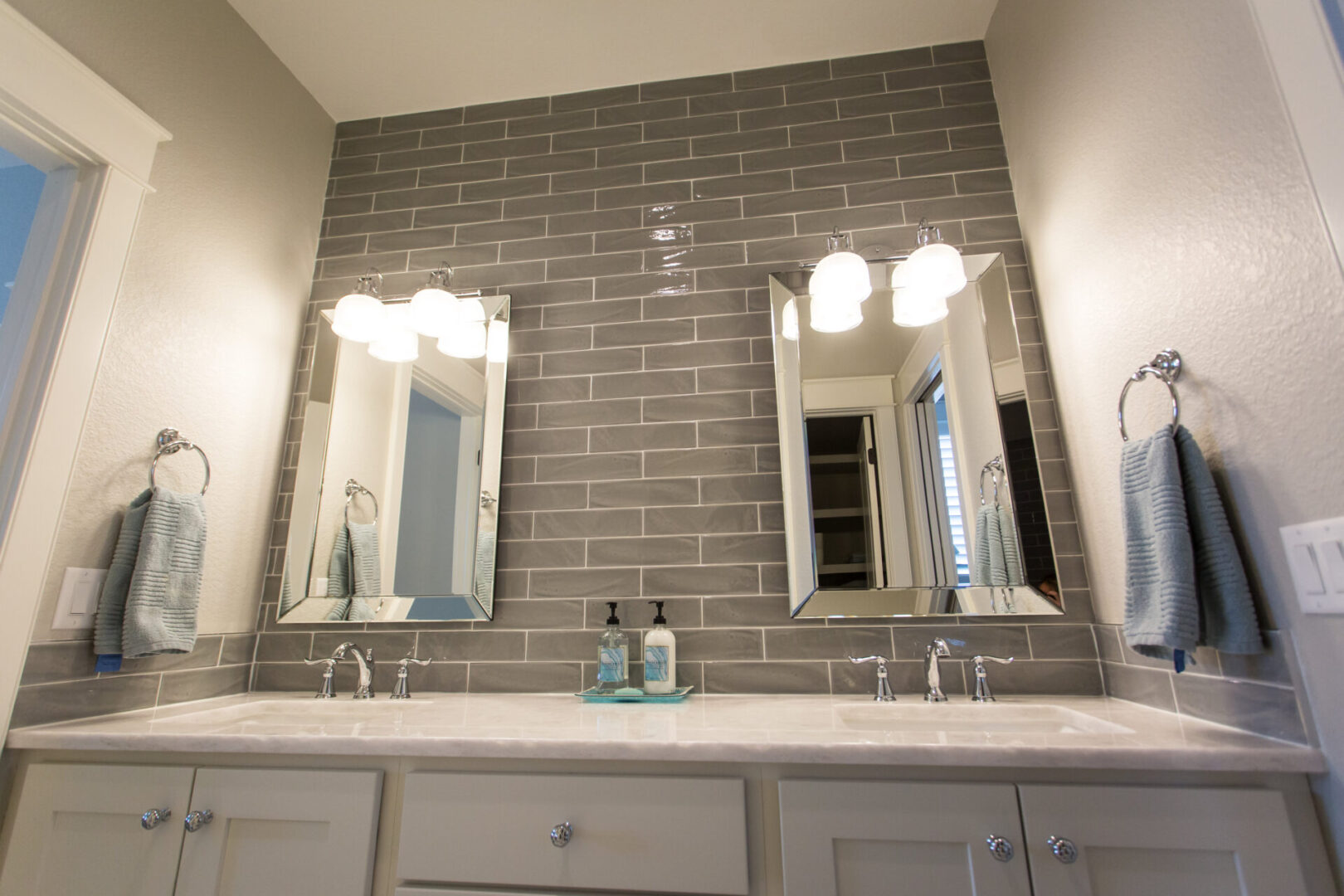 bathroom sink with mirrors and lighting