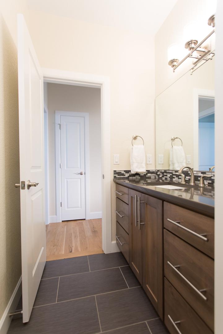 bathroom sink with dark brown accents