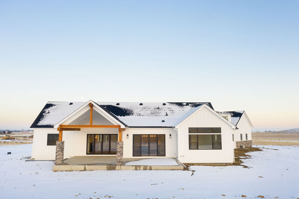 modern house with layer of snow on the surroundings