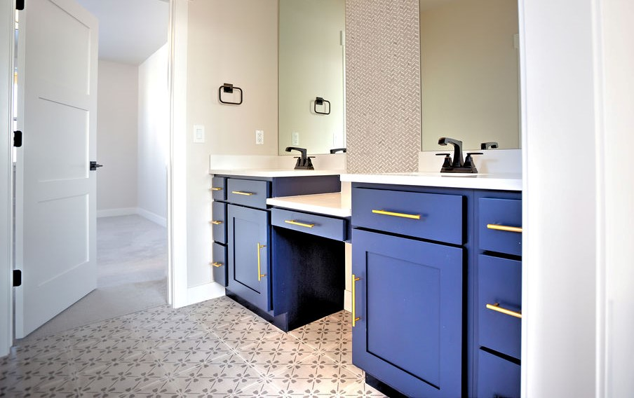 bathroom sink with blue accents