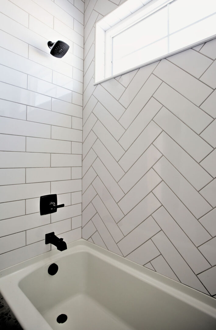 bathroom tub with diagonal tiles