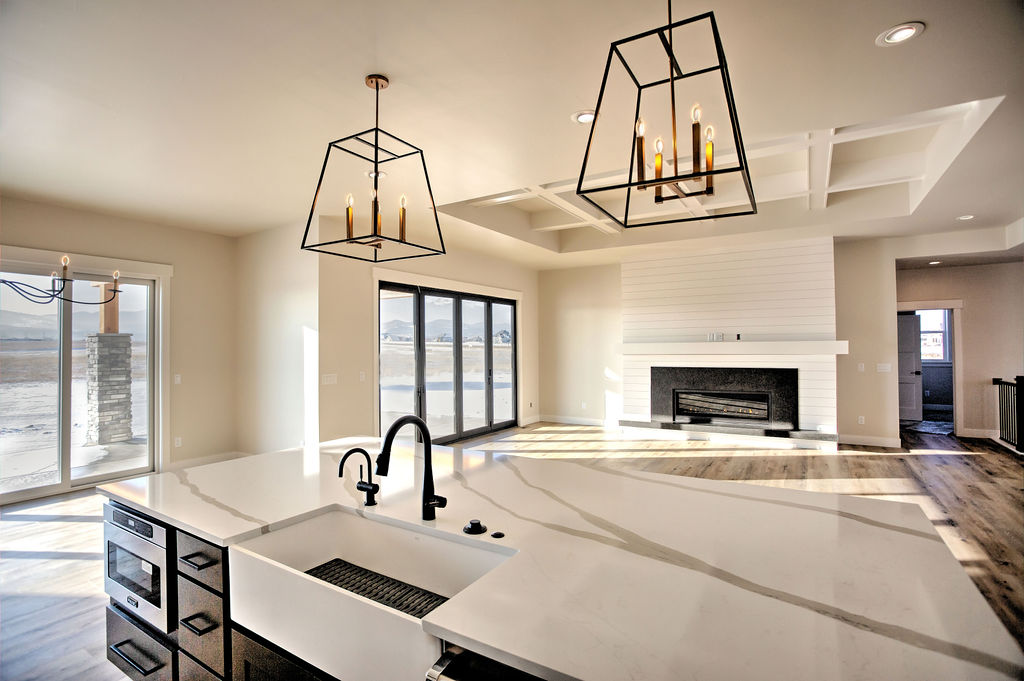 modern faucet and lights in an empty kitchen