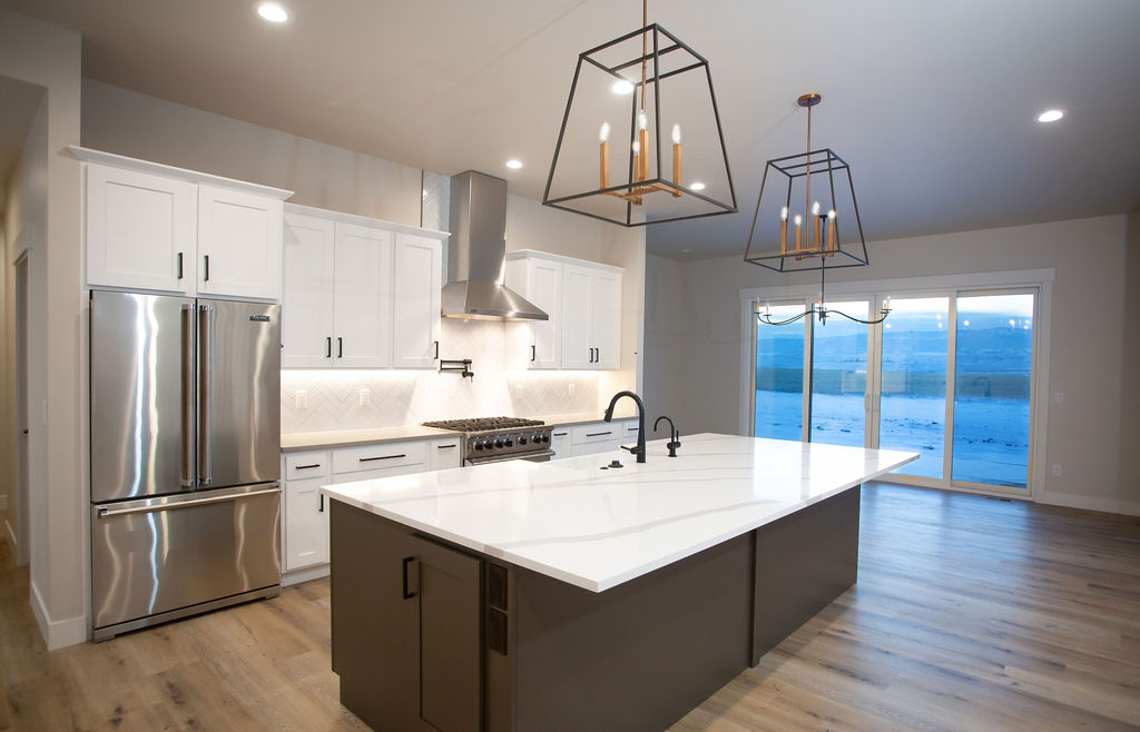 kitchen with white island and modern lighting fixtures